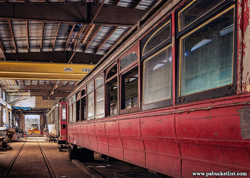 Some of the most antiquated streetcars at the Windber Trolley Graveyard sit protected from the elements inside the former Berwind Coal Company Railroad Shop.