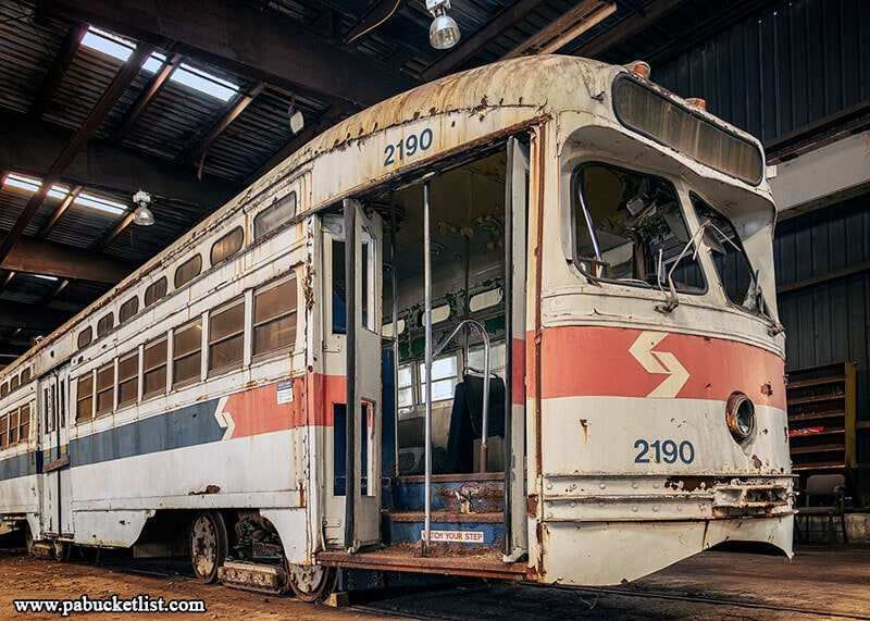 A retired SEPTA trolley sits inside the Vintage Electric Streetcar Company repair shop.
