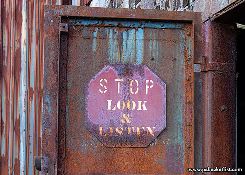 Stop, look, and listen. Good advice here at the former rail car shop of the Berwind Coal Company, now the repair shop of the Vintage Electric Streetcar Company.