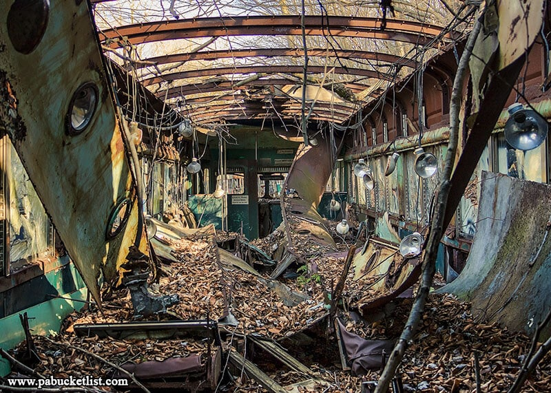 Nature and the elements have reduced many of the vintage streetcars at the Windber Trolley Graveyard to skeletons of their former selves.