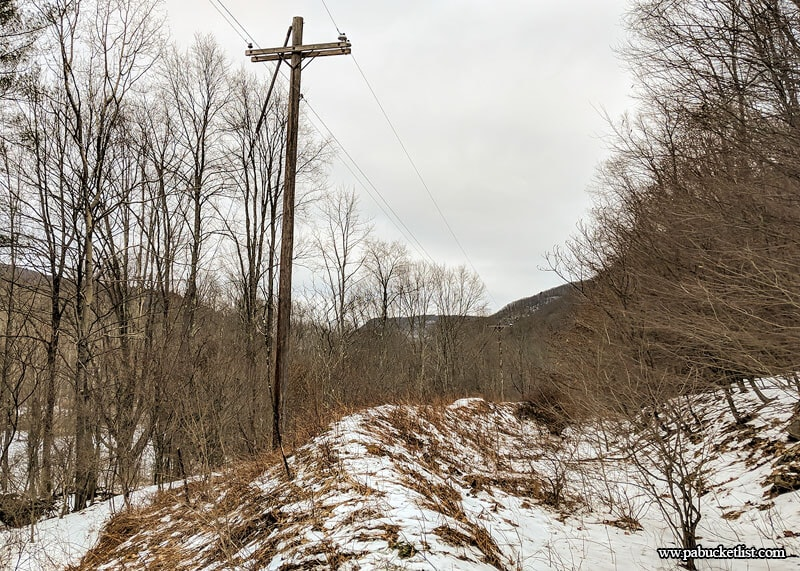 Power lines intersect the rail bed at 0.53 miles into the hike to Dutchmans Run in the McIntyre Wild Area