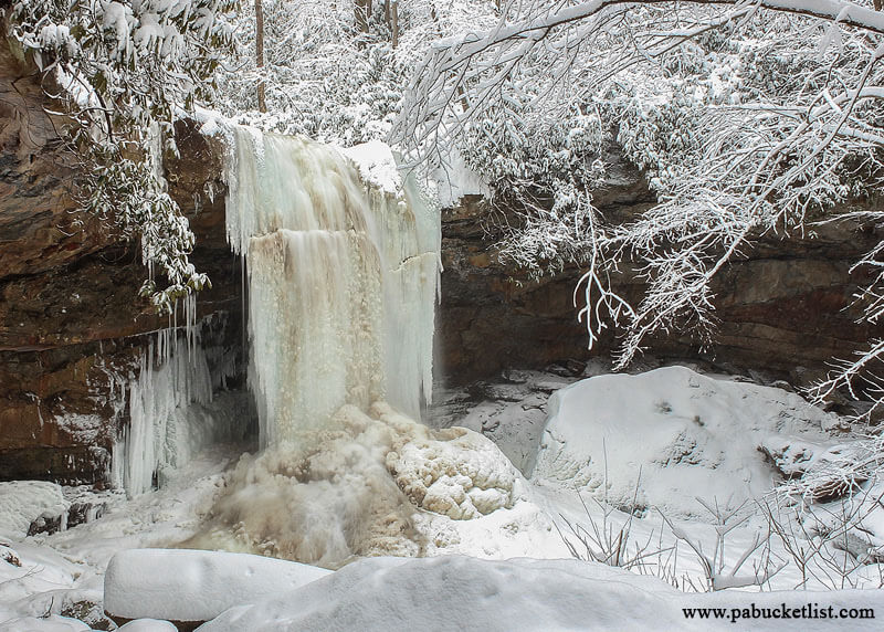 Cucumber Falls at Ohiopyle State Park is completely frozen in this winter scene.
