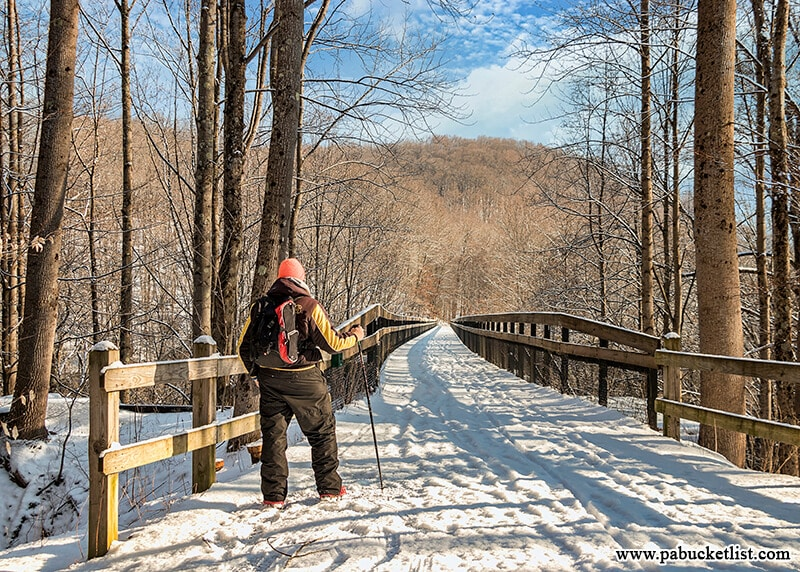 The snow covered Great Allegheny Passage as it passes over the High Bridge at Ohiopyle State Park