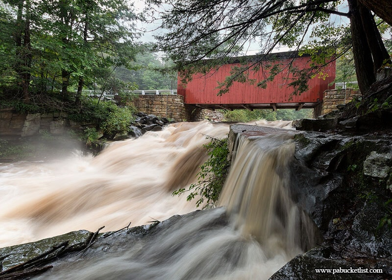 Summer downpours in the Laurel Highlands mean huge flow on Brush Creek and the waterfalls beneath the Pack Saddle Bridge.