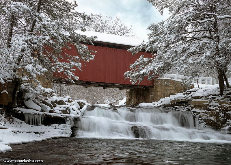 On a snowy winter day the red sides of the Pack Saddle Covered Bridge jump out like in no other season.