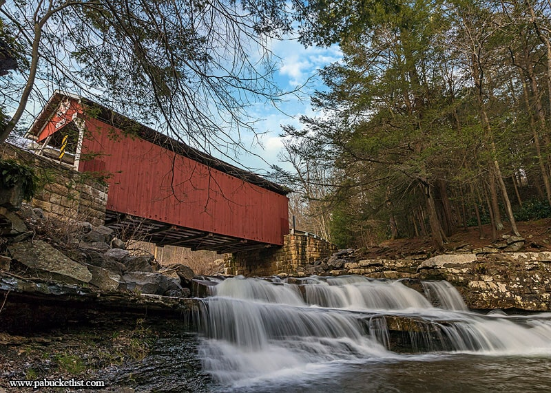 The waters of Brush Creek tumble over rocks beneath the Pack Saddle Covered Bridge, as they have for nearly 150 years.
