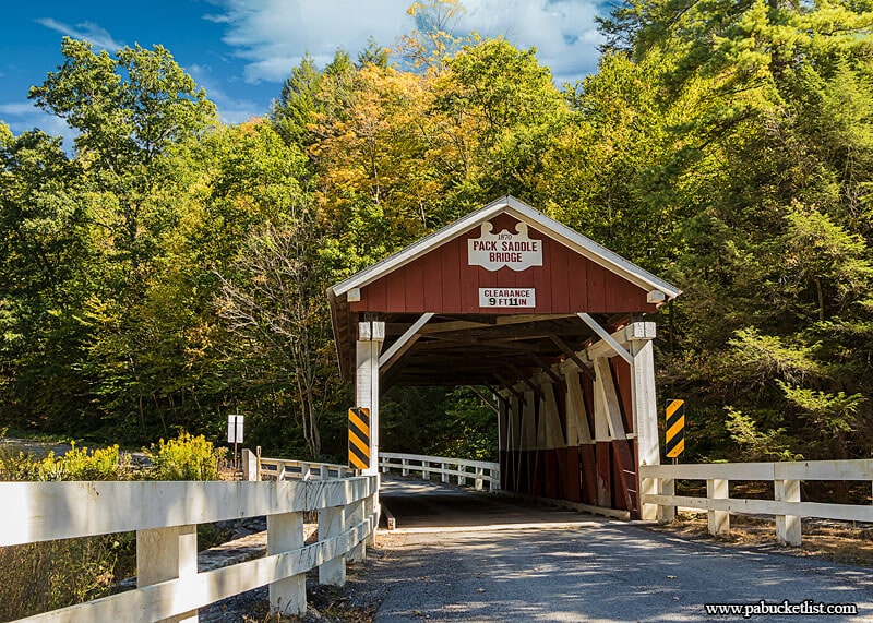 Fall foliage starting to turn in the Laurel Highlands at the Pack Saddle Covered Bridge, Somerset County, Pennsylvania.