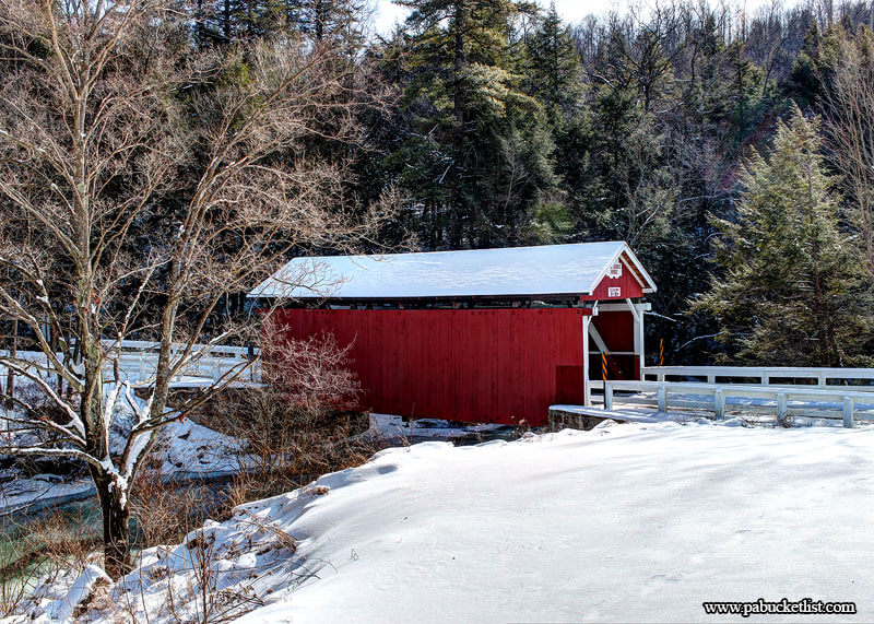 A wintertime view f the Pack Saddle Covered Bridge near Fairhope, Somerset County, PA.