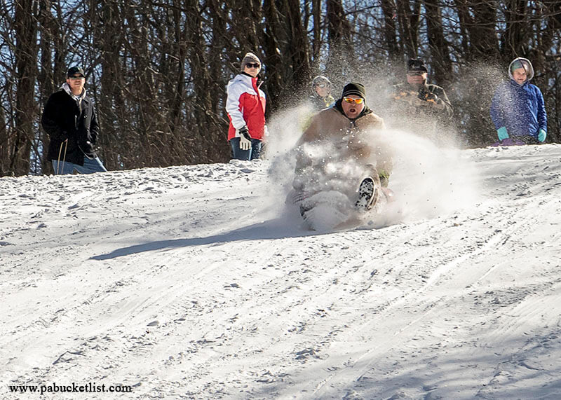 A sled rider takes off at the Sugarloaf sledding area at Ohiopyle State Park