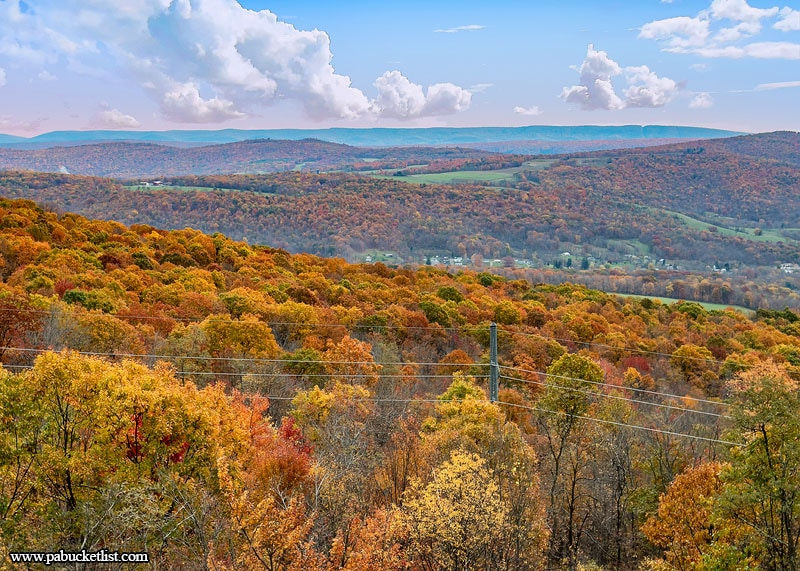 Fall foliage sets the ridges ablaze with color just south of the Big Savage Tunnel, along the Great Allegheny Passage.