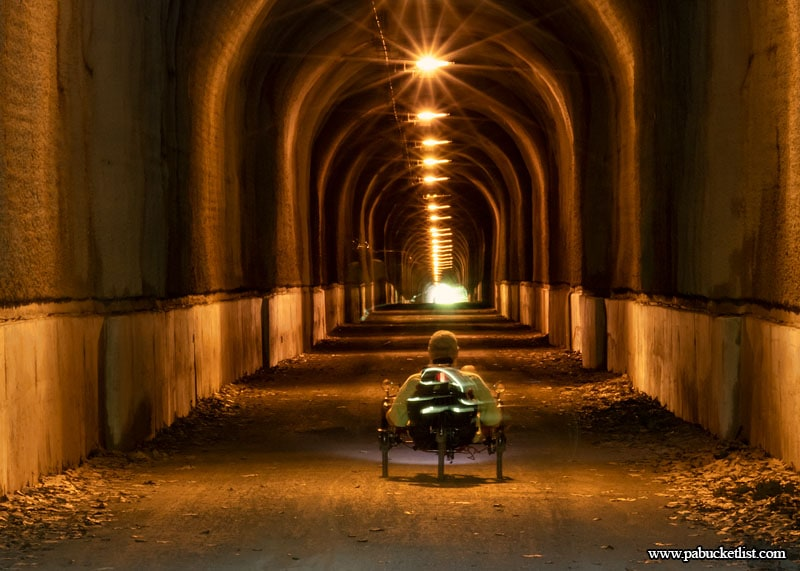 A man on a recumbent bicycle prepares to travel the 3,294 foot Big Savage Tunnel along the Great Allegheny Passage.