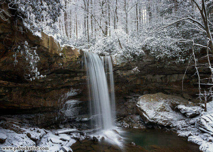 A side view of Cucumber Falls, surrounded by a blanket of snow. Ohiopyle State Park, Fayette County, PA
