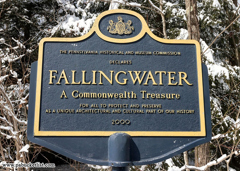 """Fallingwater historical marker declaring it """"A Commonwealth Treasure""""."""