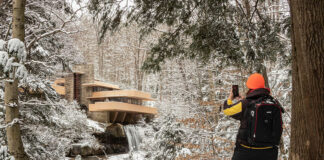 The author (Rusty Glessner) taking a photo at Fallingwater on a winter day.