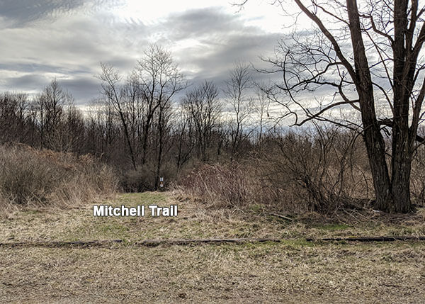 A view of the Mitchell Trail from the Old Mitchell Place parking lot.