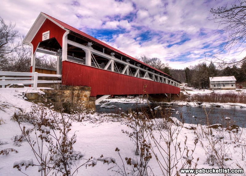 A low-angle winter view of Laurel Hill Creek and the Barronvale Covered Bridge in Somerset County PA