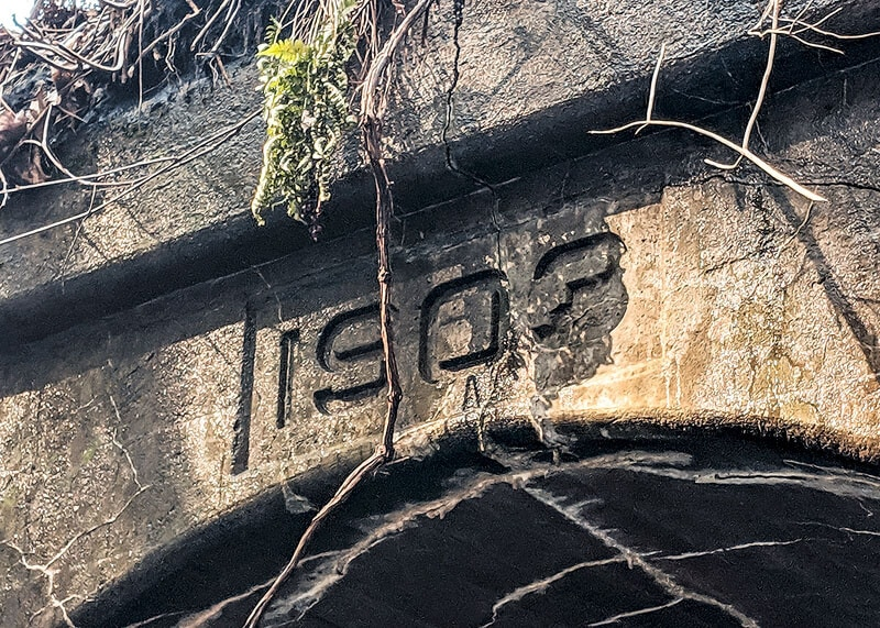 """1903"" construction date carved into the Stone Quarry Run Tunnel."