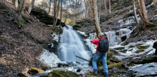 The author at Water Tank Hollow Falls, just off the Pine Creek Rail Trail.