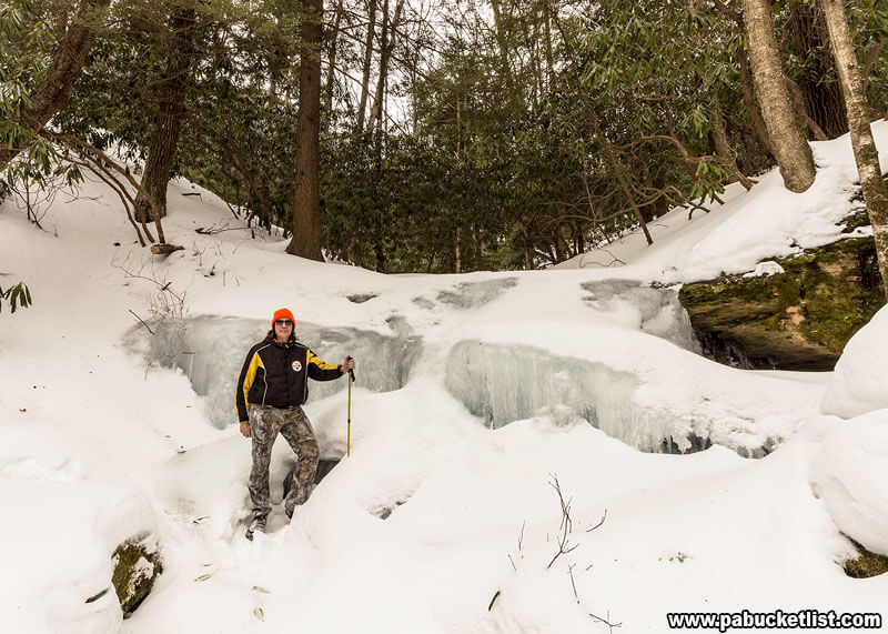 The author standing in front of frozen Kyler Fork Falls.