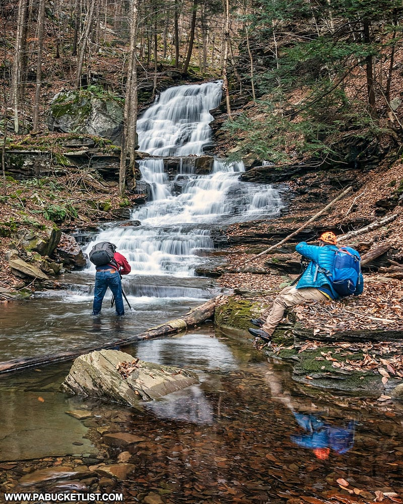 Two photographers enjoying the scenery at Hounds Run Falls in the Loyalsock State Forest.