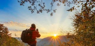 The author photographing an autumn sunrise at Baughman Rock Overlook.