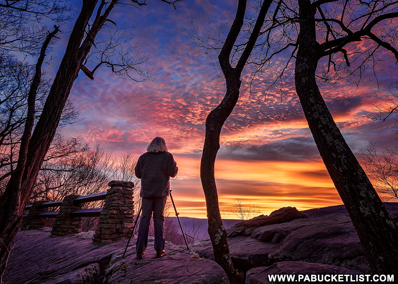 A photographer sets up to capture the sunrise at Baughman Rock Overlook, Ohiopyle State Park.
