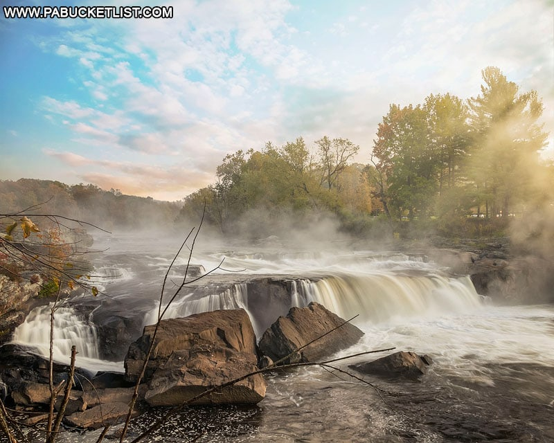 First rays of light striking Ohiopyle Falls on an autumn morning.