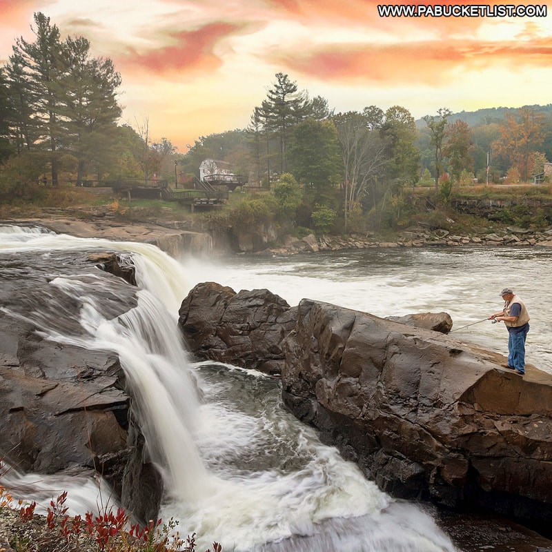 A fisherman casts a line on an autumn morning at Ohiopyle Falls.