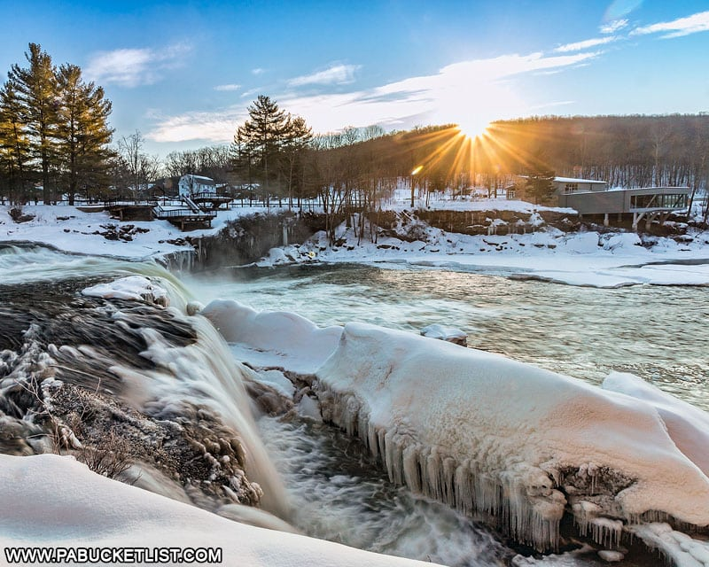 A winter sunrise over Ohiopyle Falls and the Laurel Highlands Visitors Center.
