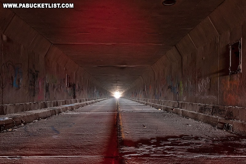 The inside of the Rays Hill Tunnel, illuminated by a red headlamp.