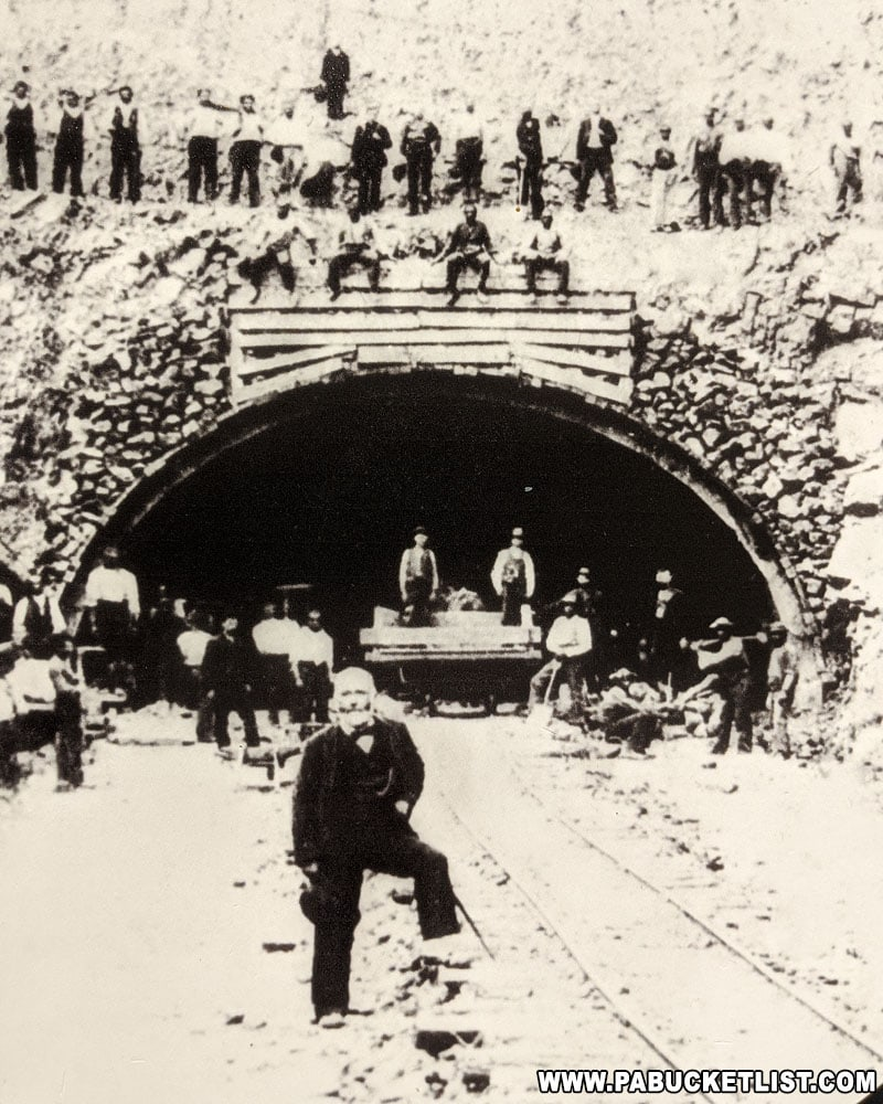 Image of Andrew Carnegie standing next to the Rays Hill Tunnel during initial construction.
