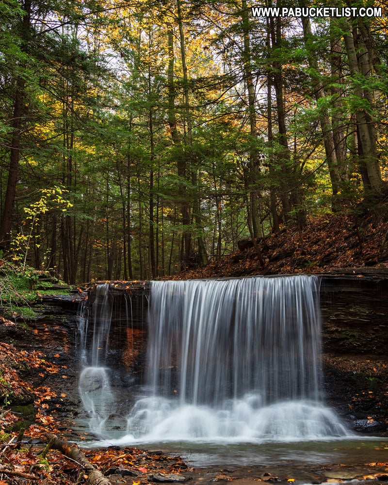 Fall foliage surrounding Grindstone Falls at McConnells Mill State Park