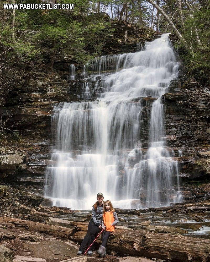 Hikers at Ganoga Falls at Ricketts Glen State Park.