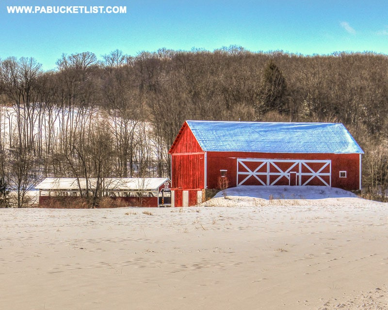 Red barn next to the Glessner Covered Bridge in Pennsylvania.