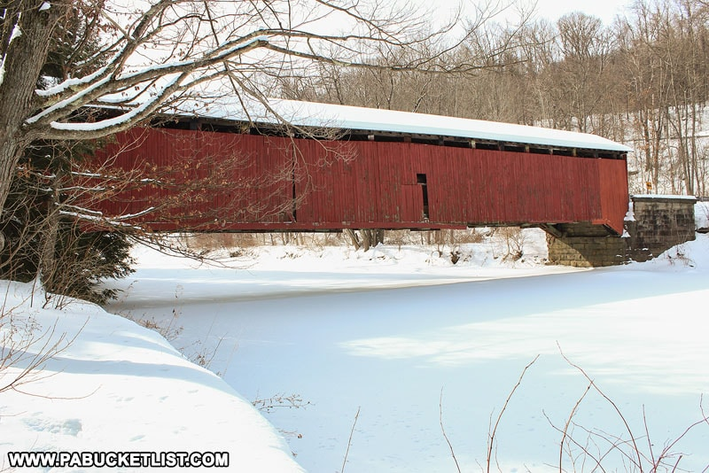McGees Mills Covered Bridge over the frozen West Branch of the Susquehanna River