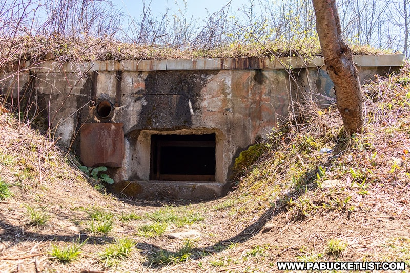 Exposed entrance to the southern nuclear jet engine testing bunker, now buried under a mound of dirt.