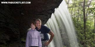 Standing behind Round Island Run Falls in Clinton County Pennsylvania
