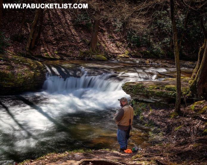 A fisherman at Wykoff Run Falls in Cameron County