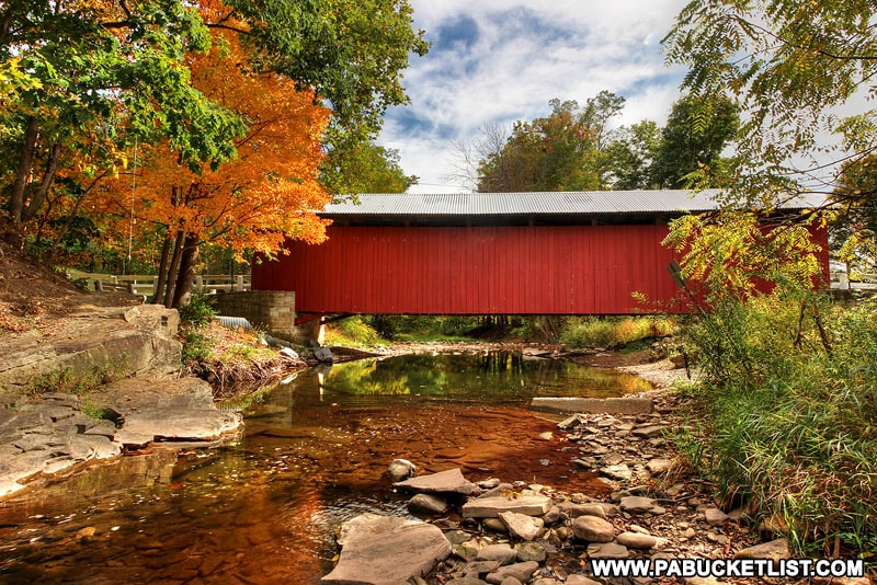 New Baltimore Covered Bridge surrounded by fall foliage.