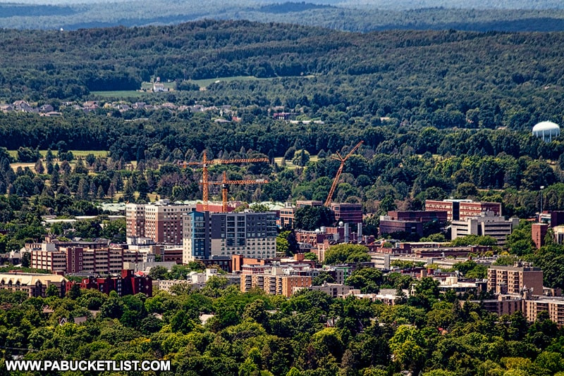 Construction cranes in downtown State College visible from Mount Nittany.