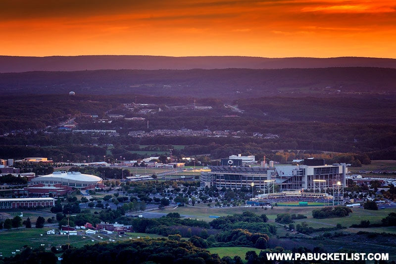 Summer sunset over Penn State campus while a baseball game takes place at Medlar Field..