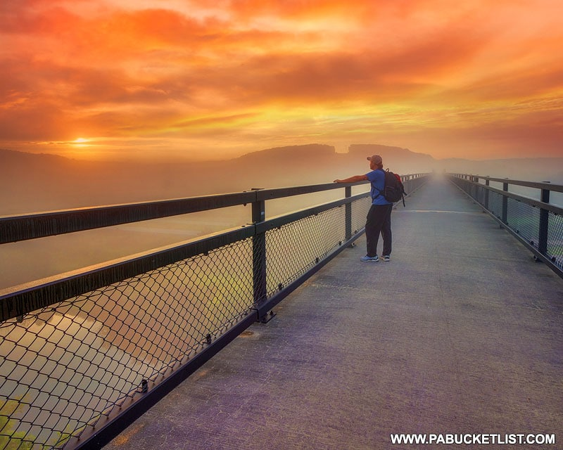 Rusty Glessner taking in the sunrise over the Salisbury Viaduct.
