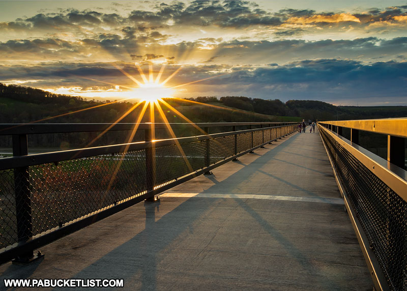 Hikers taking in the sunset from the Salisbury Viaduct along the Great Allegheny Passage.