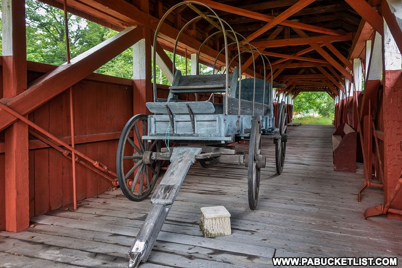 Conestoga wagon on display inside the Trostletown Covered Bridge.
