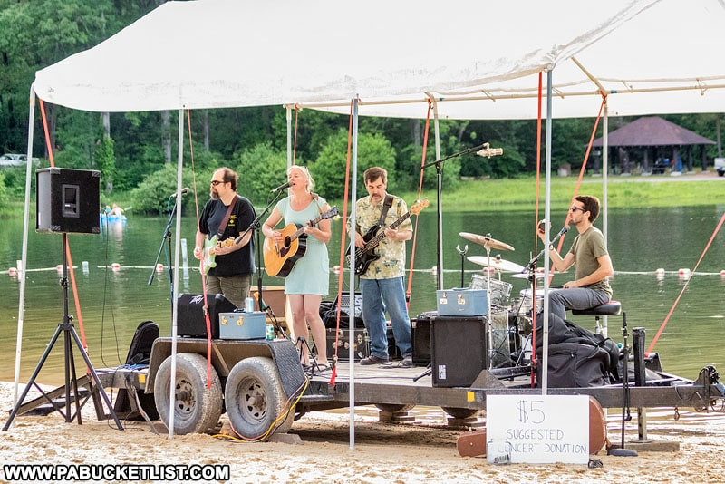 Band performing on the beach at Whipple Dam State Park.