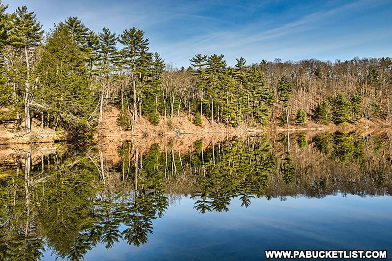 Reflections on Whipple Lake at Whipple Dam State Park.