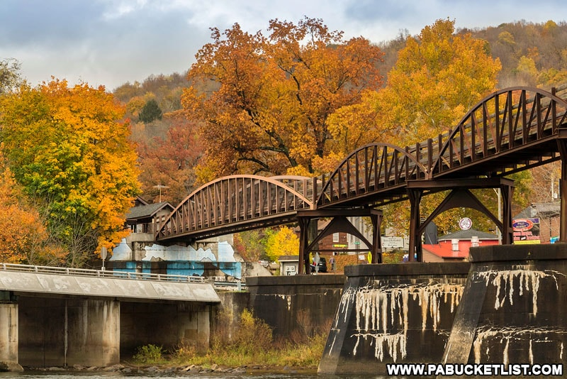 The Low Bridge over the Youghiogheny River surrounded by fall foliage.