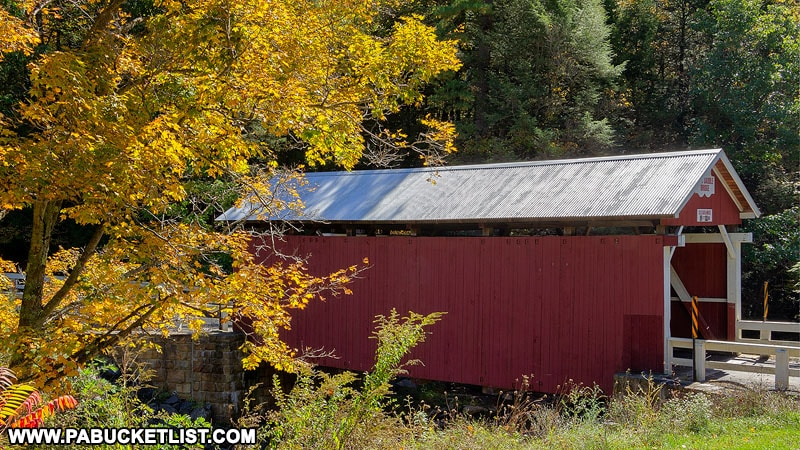 Fall foliage at the Pack Saddle Covered Bridge in the Laurel Highlands of PA.