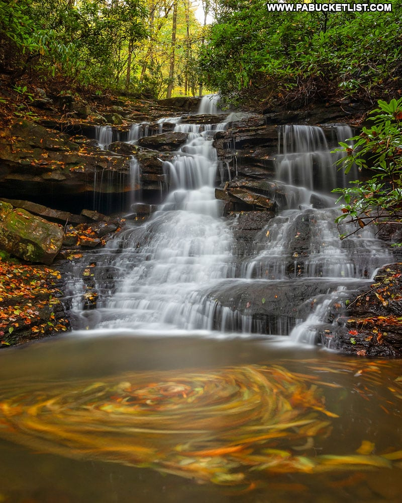 Fall foliage leaf swirls at Sugar Run Falls at Ohiopyle State Park.