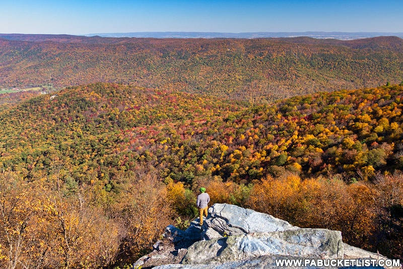 A hiker takes in the view from Big Mountain Overlook in Fulton County PA